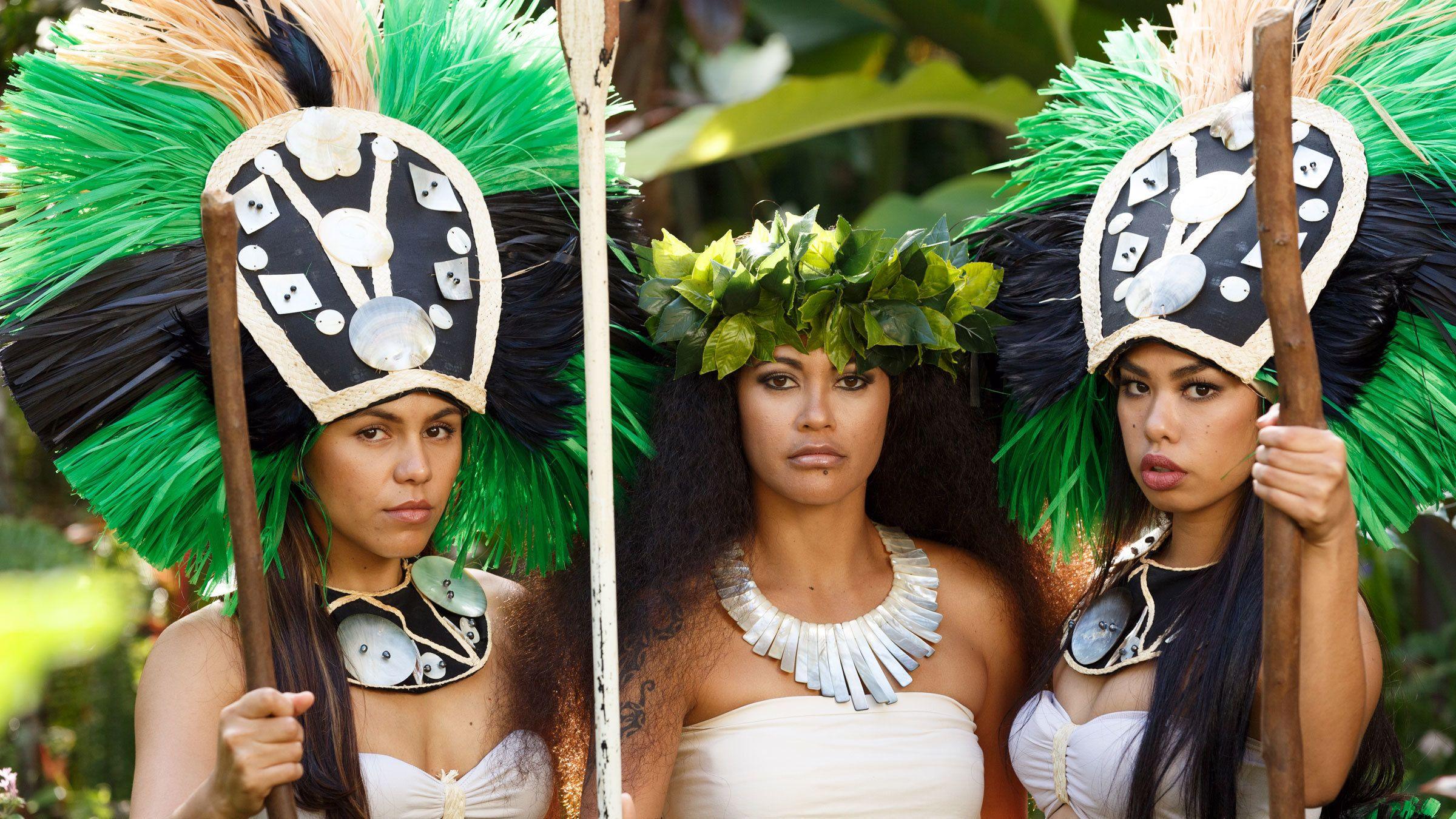 Three women in traditional island clothing in Kauai