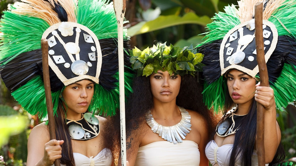 Show item 9 of 9. Three women in traditional island clothing in Kauai