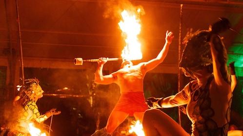 performer breathing fire at luau in Kauai