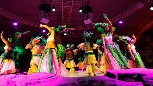 seven Hawaiian dancers dancing at luau in Kauai