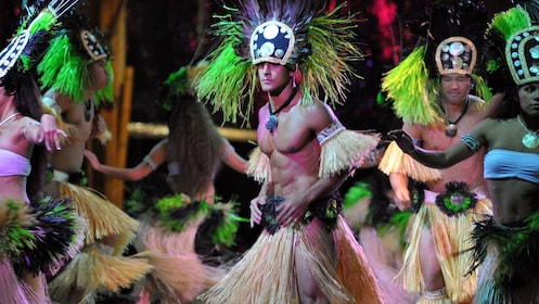 group of Hawaiian dancers dancing at luau in Kauai
