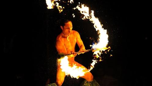 man dancing with fire at luau in Kauai