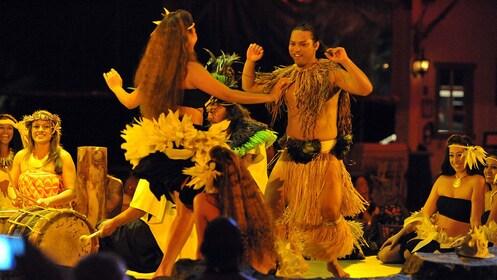 Hawaiian dancers hula dancing at luau in Kauai