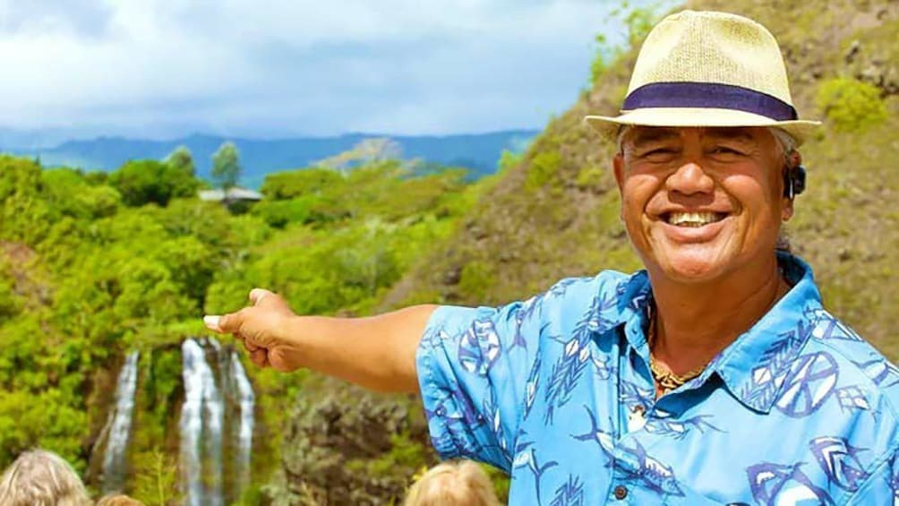 Close up of man pointing at beautiful view on the distance.