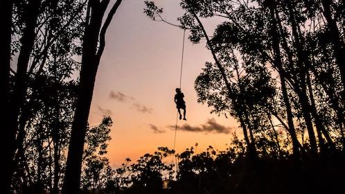 Guest ziplining at sunset in Kauai