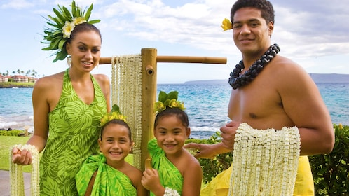 Couple with kids performing in the Te Au Moana Luau in Maui