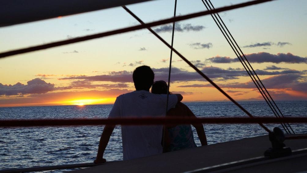 Couple enjoying sunset on boat