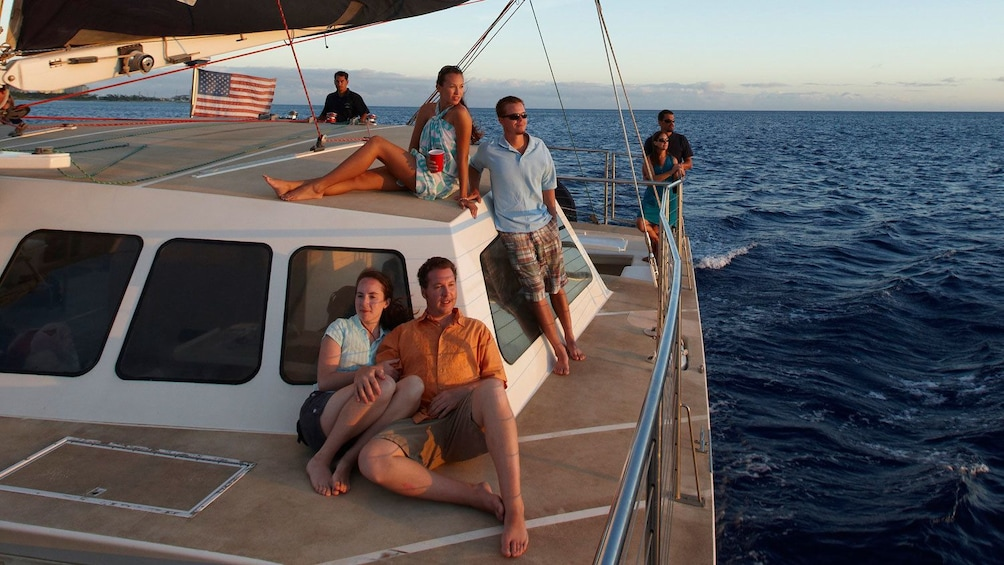 Friends lounging on deck of boat