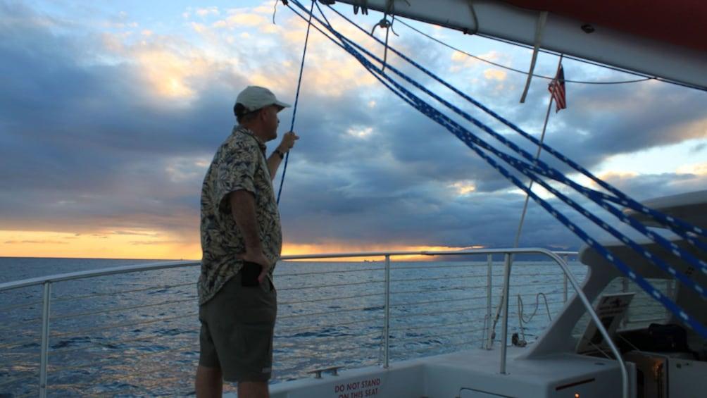 Man looking at ocean from boat