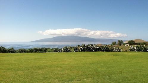 a large open field near the beach in Maui