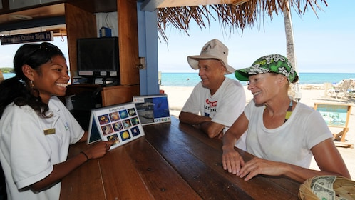 Couple with sales rep at ocean sports booth on Big Island