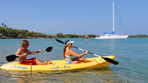 Couple kayaking on the Pacific Ocean near the Big Island of Hawaii