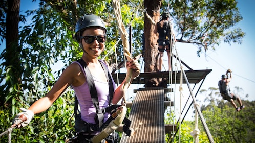 Young woman about to go ziplining in Maui