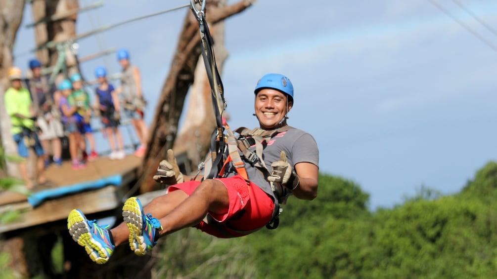 Show item 1 of 11. Man ziplining in Maui