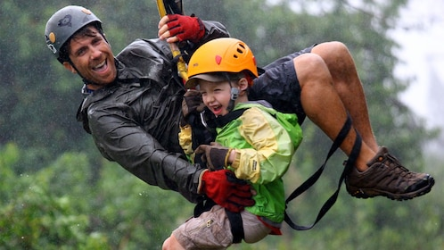 Man and child ziplining together in Maui