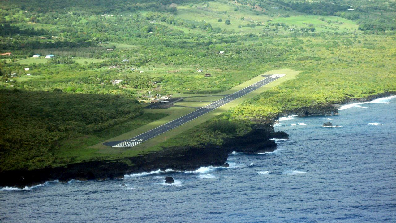 Aerial of runway next to the shore in the Fly and sightsee Maui with Hana landing in Maui