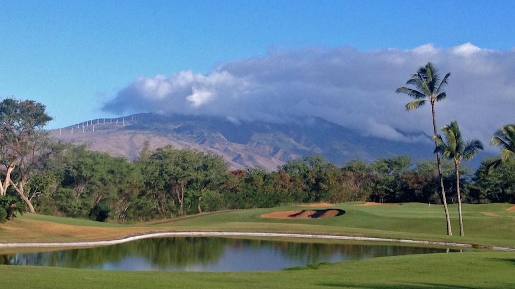 Show item 3 of 5. Mountain view from golf course in Maui