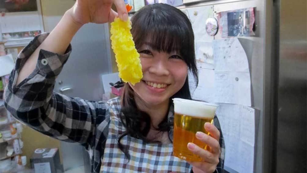 Show item 1 of 5. Woman with shrimp tempura and a glass of beer in Nagoya, Japan
