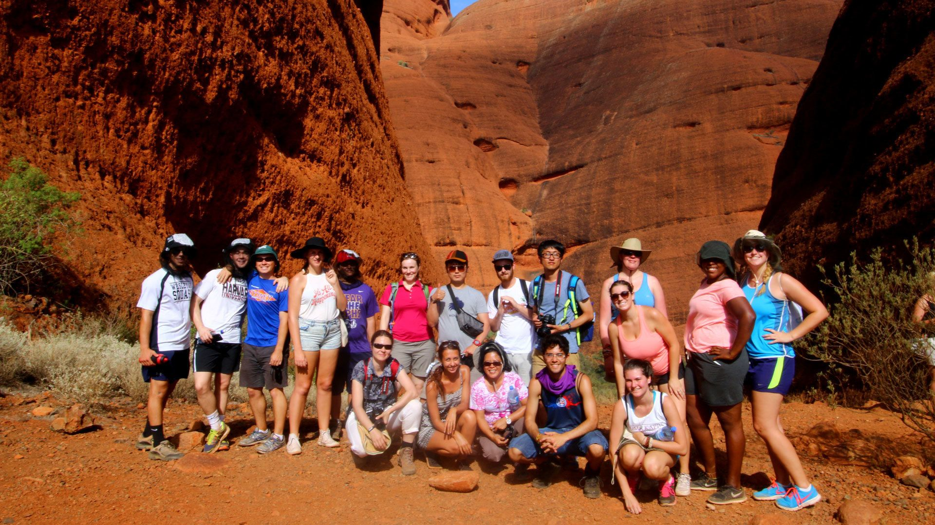 Hiking group in front of large rock formations