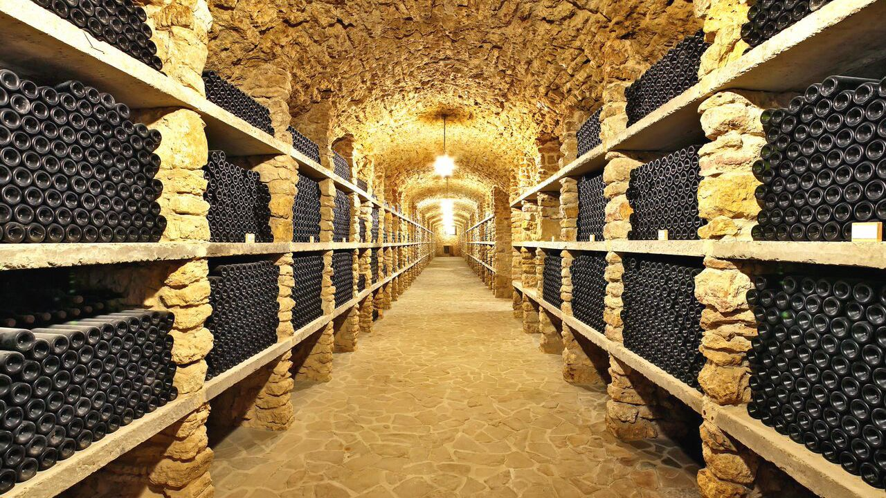 Interior view of wine cellar with several bottles of wine.