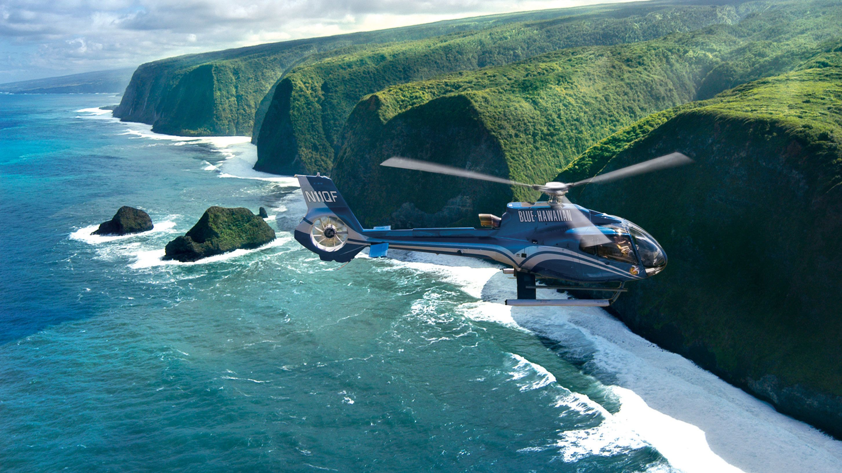 Helicopter fly over cliffs on the Hawaii shore line