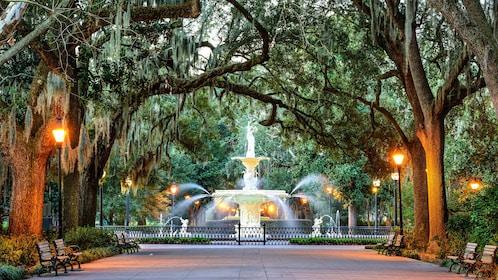 A fountain in Savannah Georgia under trees