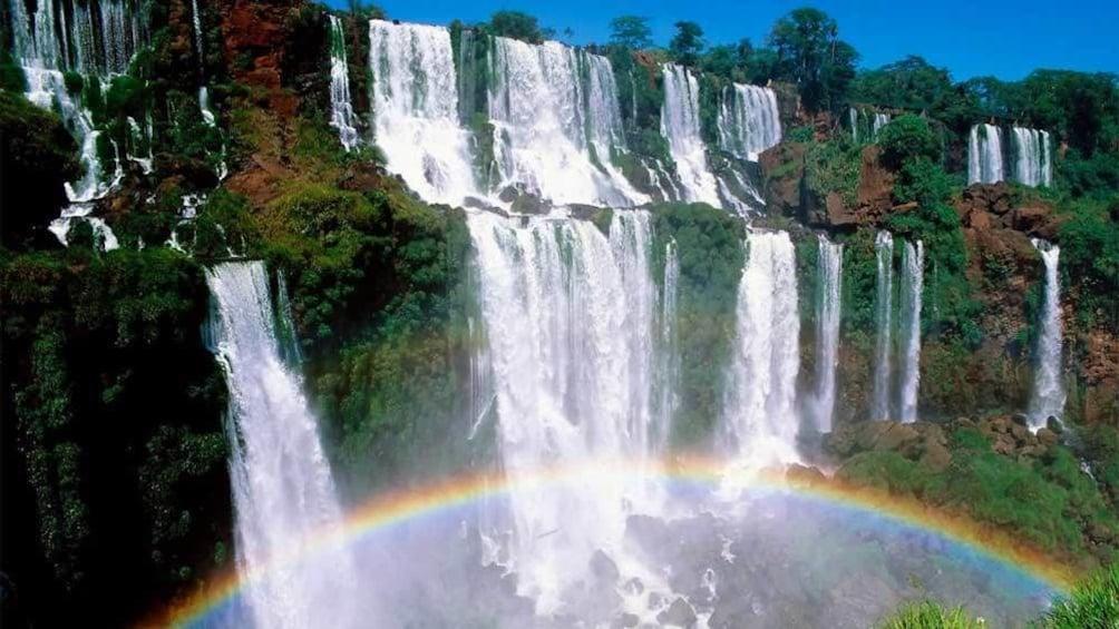 Cargar ítem 1 de 10. Rainbow seen at the Iguazu Falls in  Buenos Aires, Argentina