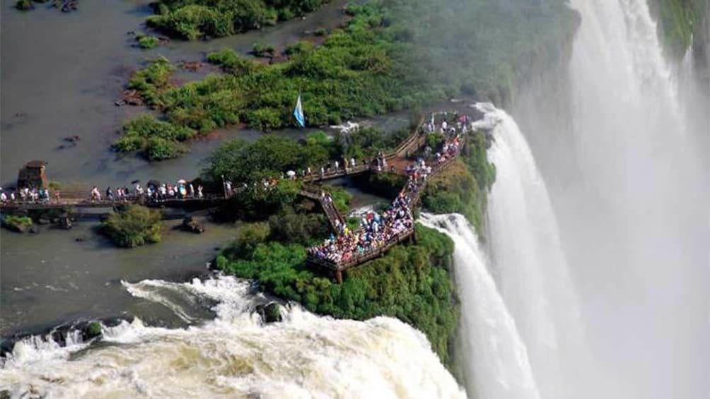 Cargar ítem 2 de 10. Day view of tourists at the Iguazu Falls in Buenos Aires, Argentina