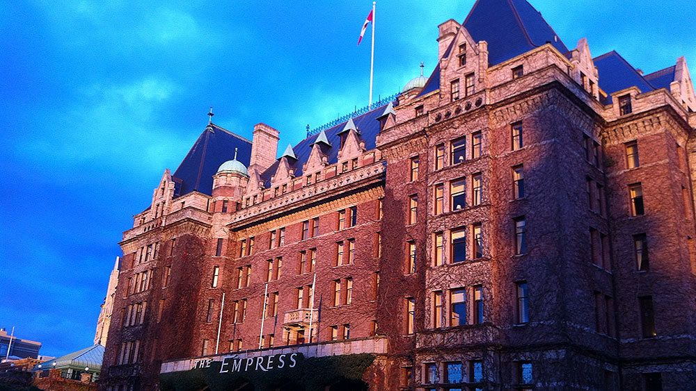 The Empress hotel with long shadows covering the sides of the building at twilight in Vancouver