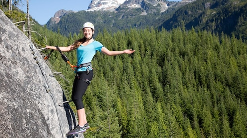 woman climbing up the tall rocks in Squamish