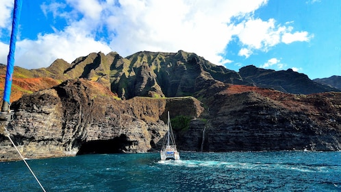 sailboat exploring ocean cove of island in Kauai