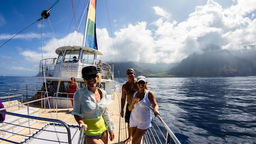passengers enjoy a trip on sailboat in Kauai