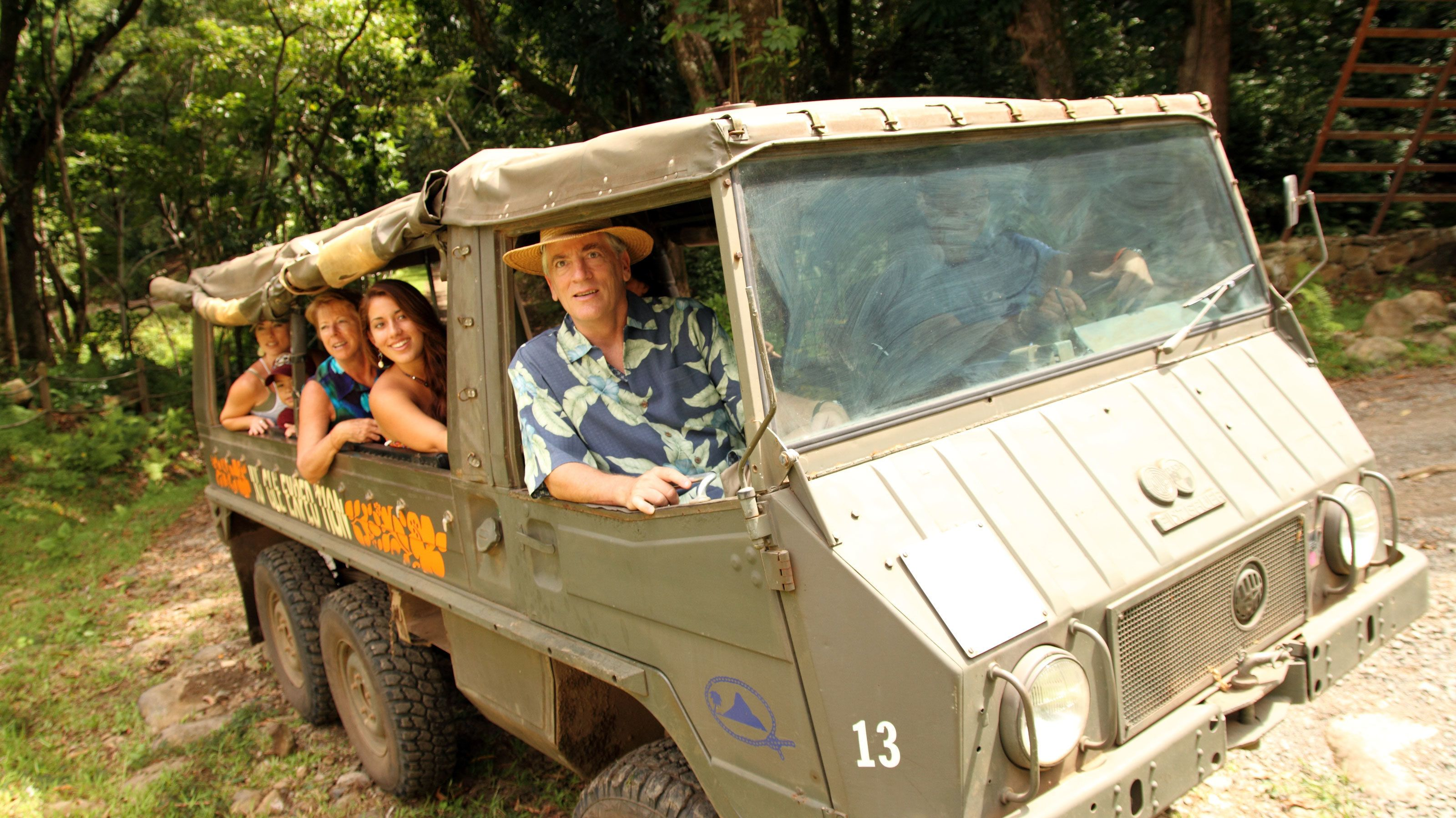 Group on touring vehicle on Oahu
