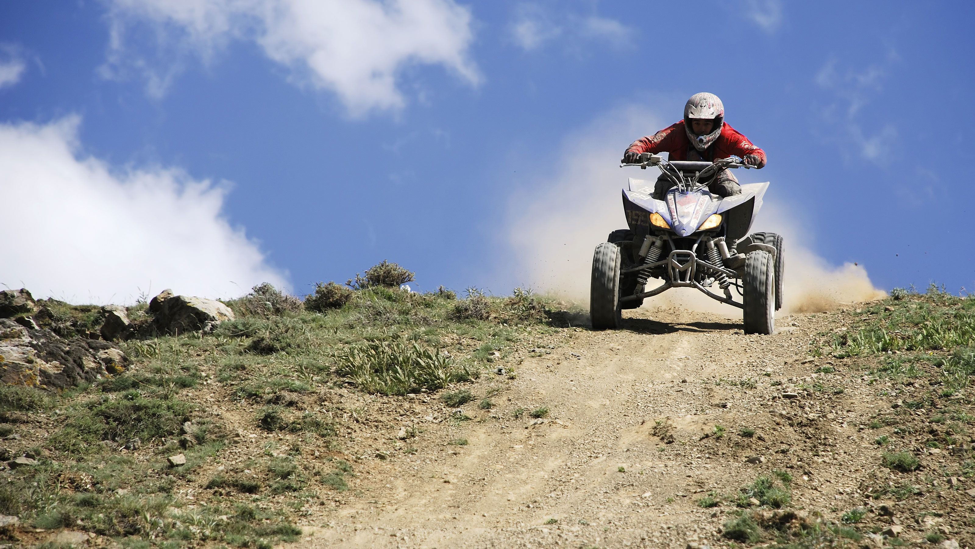 ATV rider on dirt trail