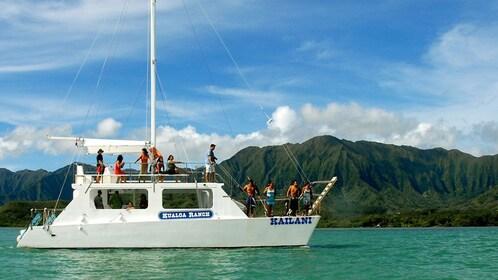 Enjoy a cruise through Kanaohe Bay on a catamaran