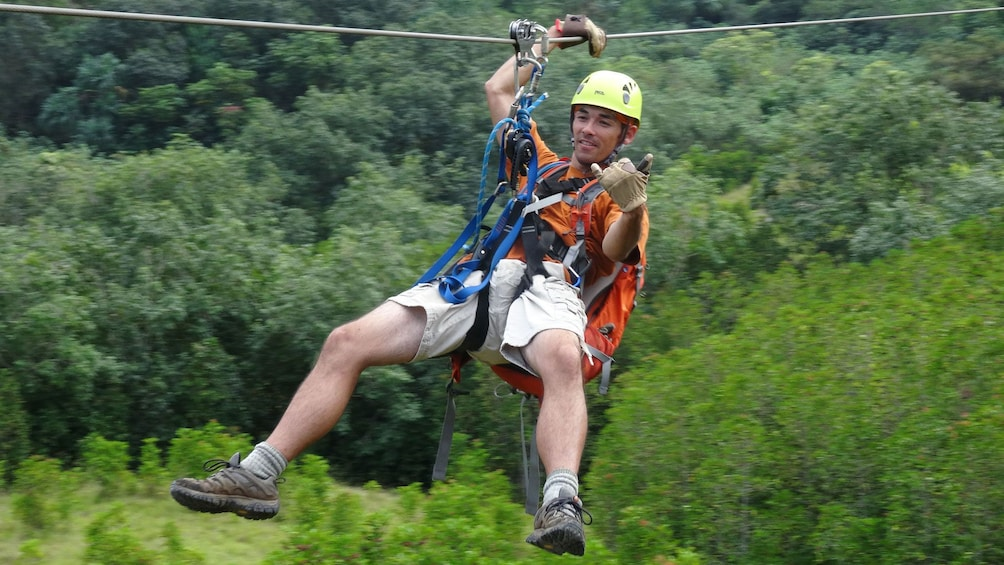 Show item 3 of 8. Have fun and enjoy the ride ziplining from Kualoa Ranch