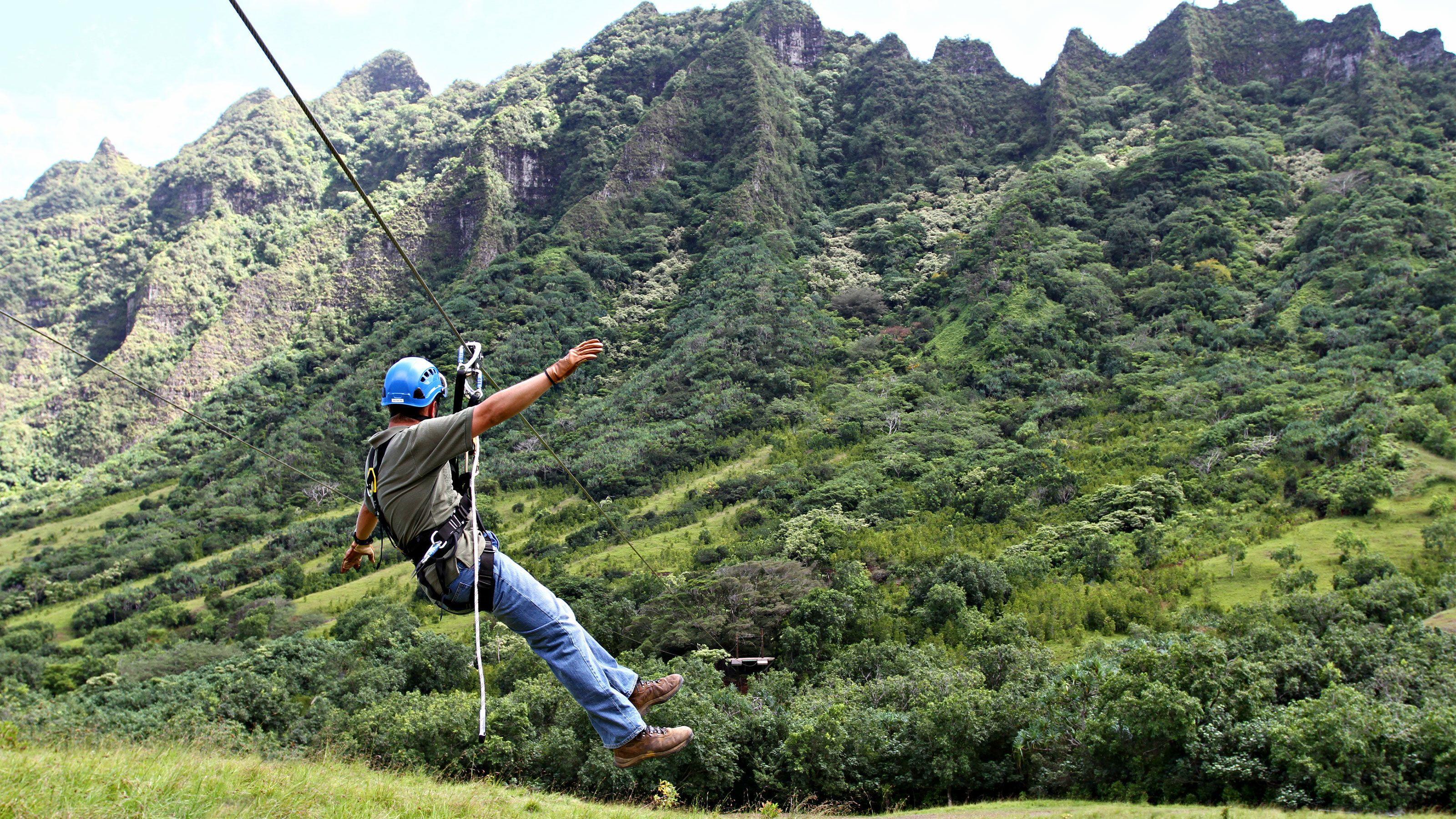 Zipline down the Ka'a'awa Valley from Kualoa Ranch in Oahu