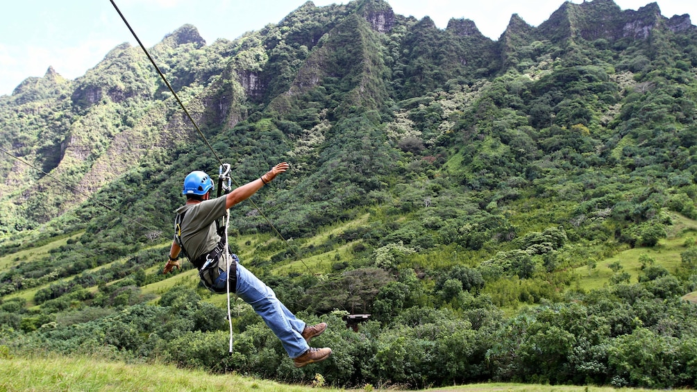 Show item 1 of 8. Zipline down the Ka'a'awa Valley from Kualoa Ranch in Oahu