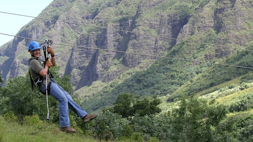 Enjoy the scenery while ziplining down Ka'a'awa Valley