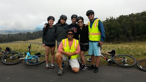 A group of Bicyclists riding to the ocean on Maui