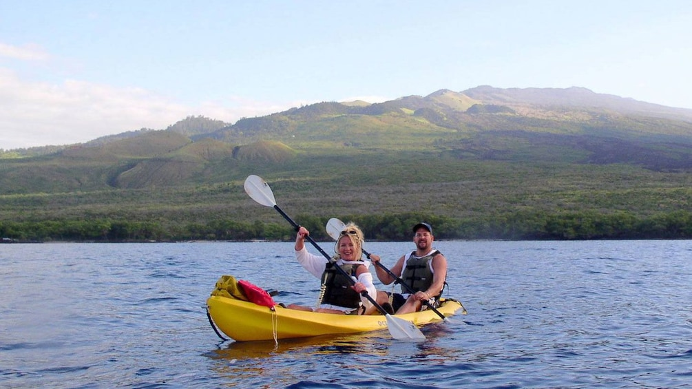 Show item 3 of 7. People in tandem kayak off of Maui
