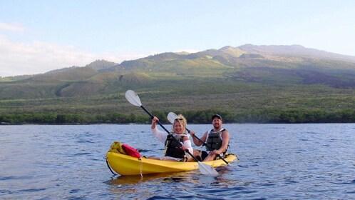 People in tandem kayak off of Maui
