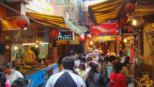 Several people waking about Jiufen marketplace.