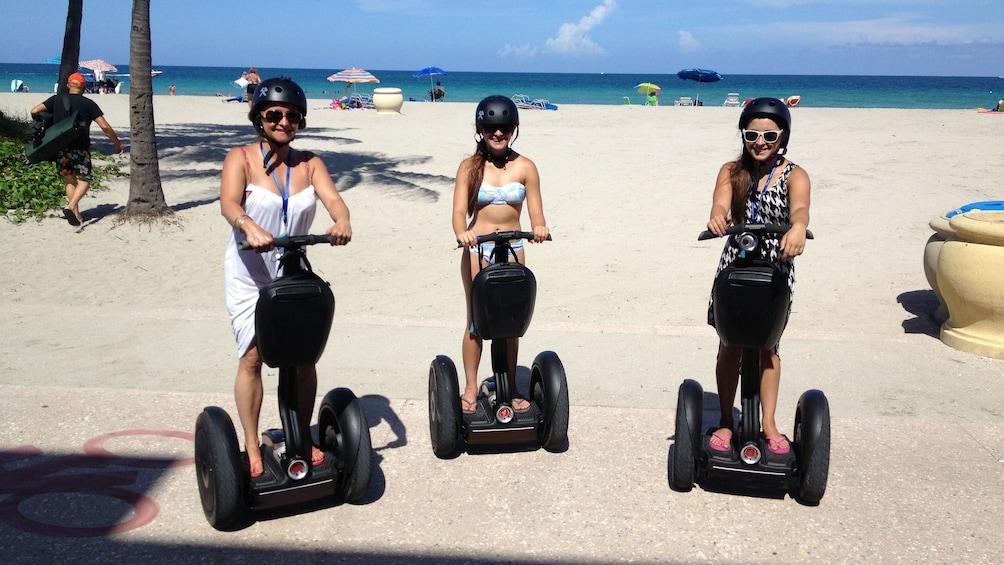 Show item 1 of 5. Trio of women on segways near Hollywood Beach