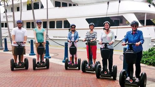 segway riders near a docked ship in Florida