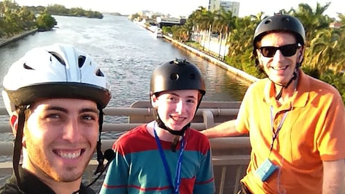 segway riders on a short bridge over the water in Florida