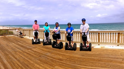 group on segway on a wooden boardwalk in Florida