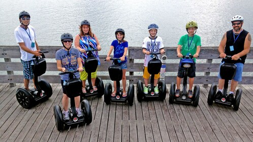 group of segway riders on a wooden boardwalk in Florida
