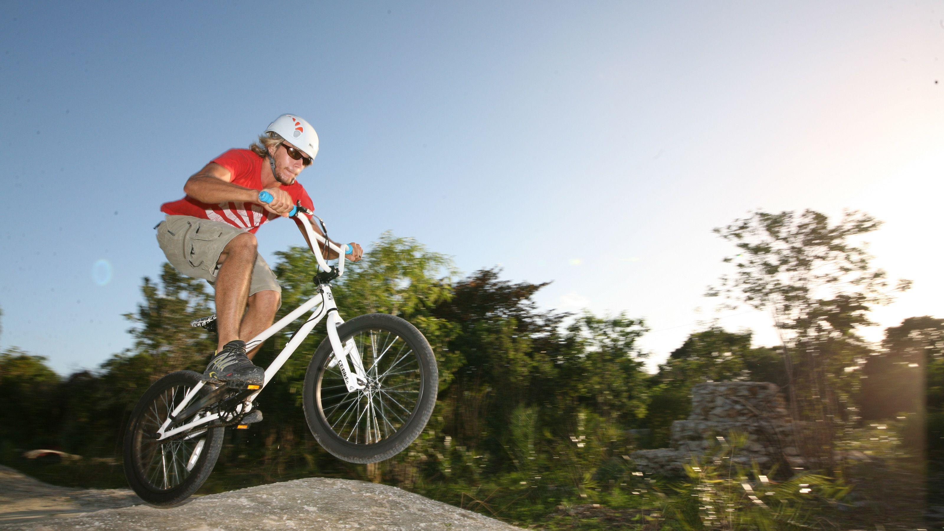man riding Mountain bike in park in Santo Domingo