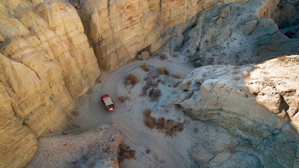 Show item 1 of 5. Aerial view of a jeep parked near the San Andreas Fault in Palm Springs